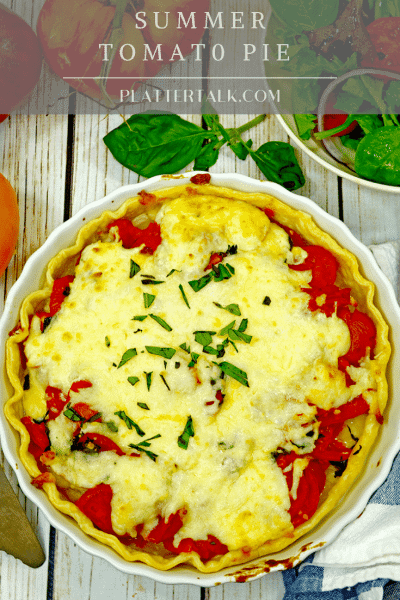 Tomato Pie with Cheese on top in a pie plate.