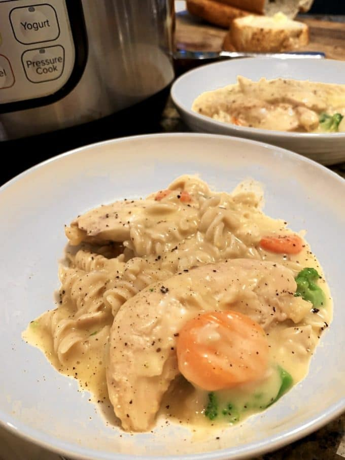 Plate of Instant Pot Creamy Chicken with vegetables.