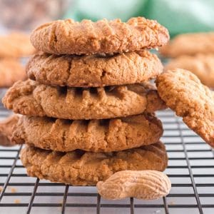 Stack of peanut butter cookies on a cooling rack.