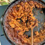 Cast-iron skillet full of instant pot baked beans