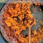 A pan of food, with Baked beans