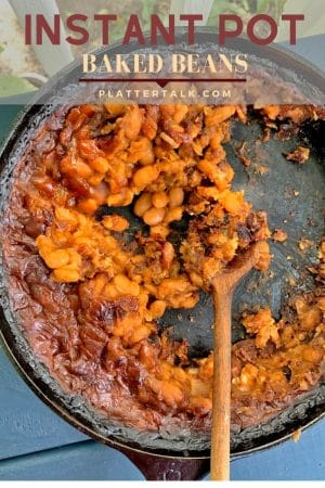 Iron skillet half-full of insgant pot baked beans.