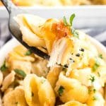 Scoop of pasta casserole with pieces of pasta and chiccken.