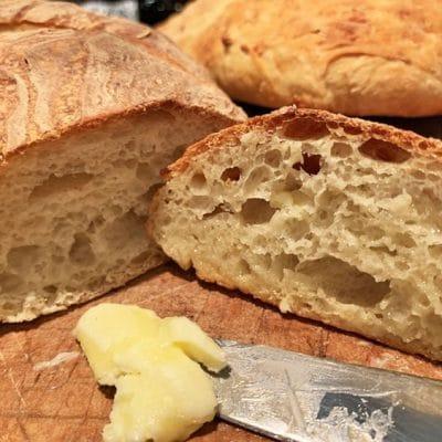 homemade crusty bread on a cutting board