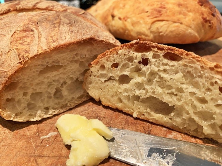Fresh slice of homemade bread with butter.