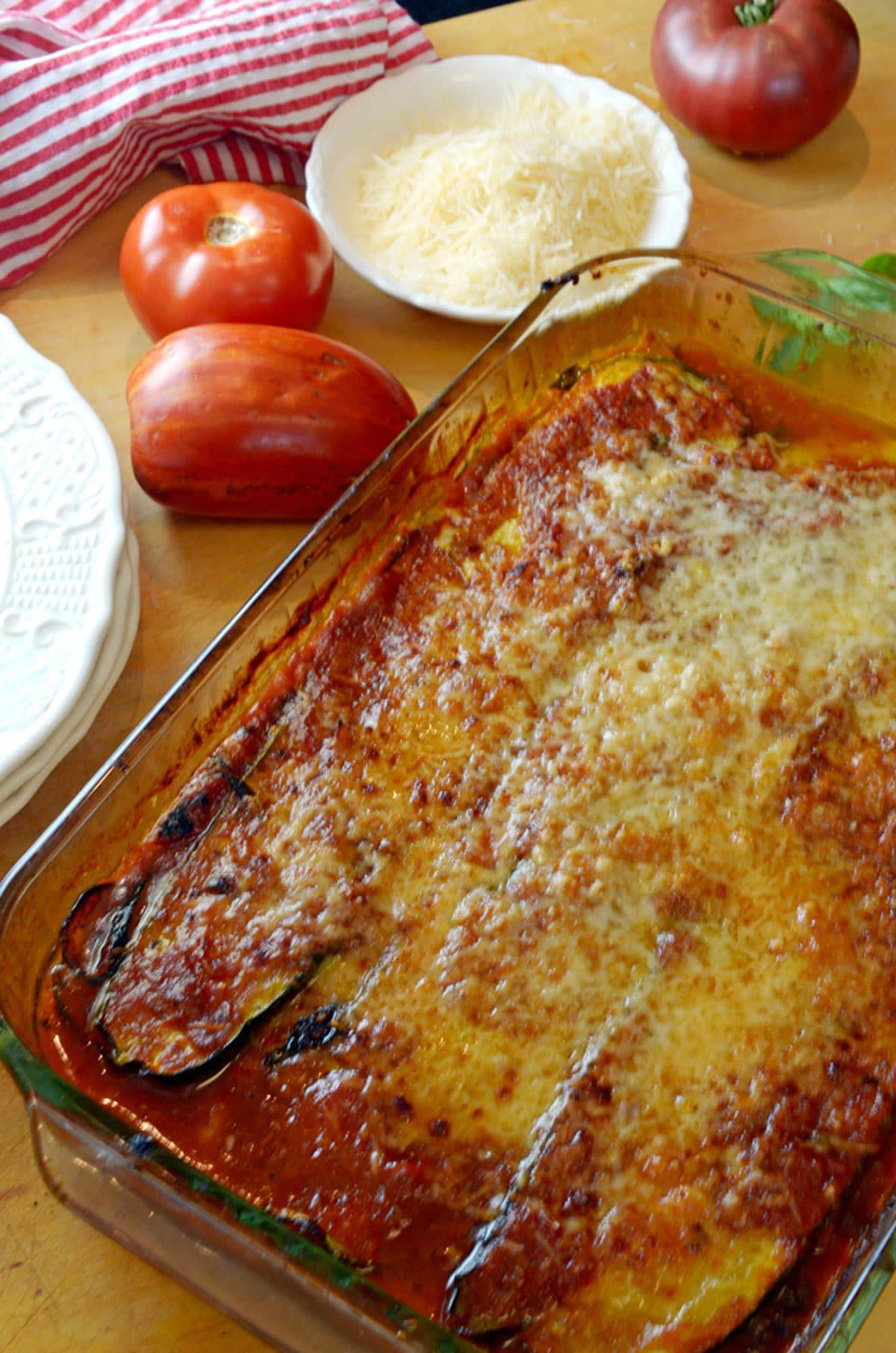 Casserole dish of baked zucchini with parmesan cheese