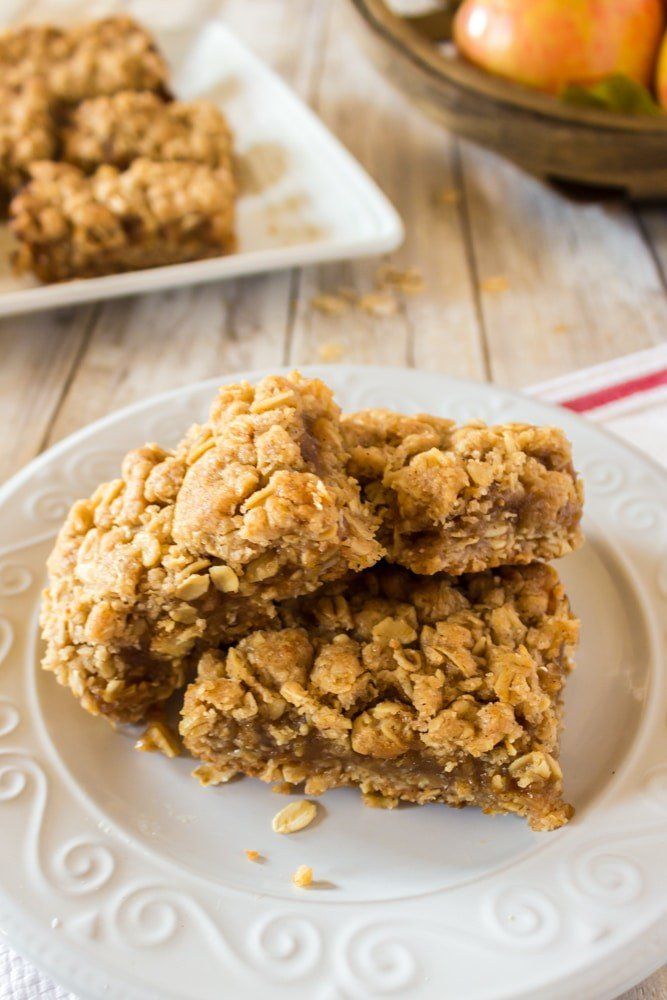 Plate of oatmeal bars with apple butter filling.