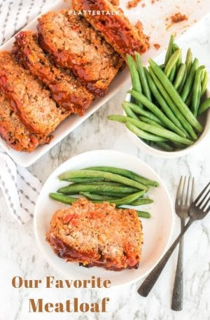 Slices of meatloaf with green beans.