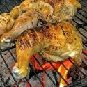 Chickn leg quarter on a hot grill.