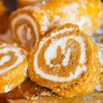 A pumpkin cake roll cut in half