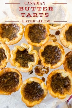 Canadian butter tarts on a serving plate.
