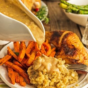 Gravy bowl over chicken dressing and carrots.