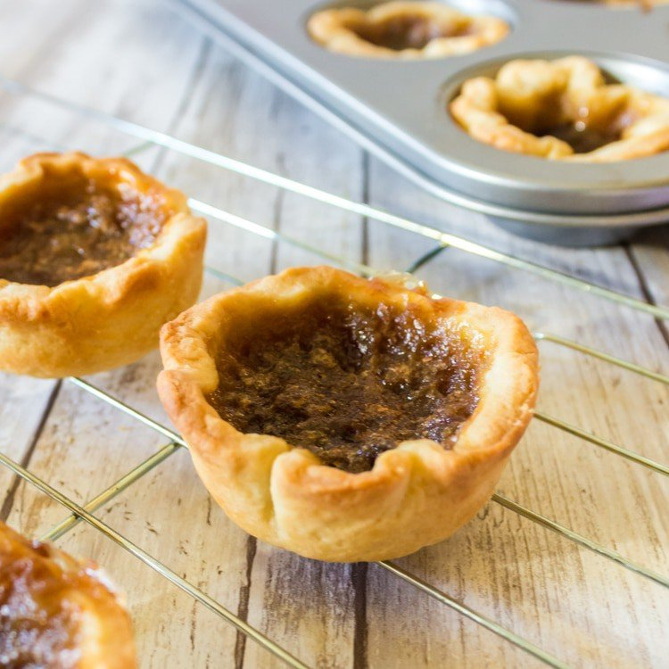 Butter Tarts on a cooling rack.