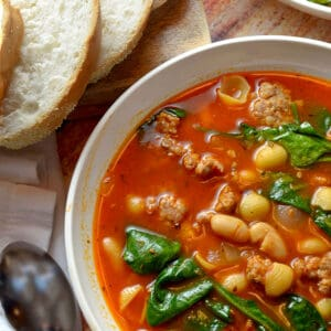 A bowl of sausage and bean soup.