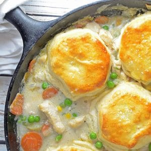 Chicken and Biscuits Pot PIe in a black cast-iron skillet.