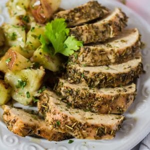 Plattrer of turkkey tenderloing sprinkled with dried herbs.