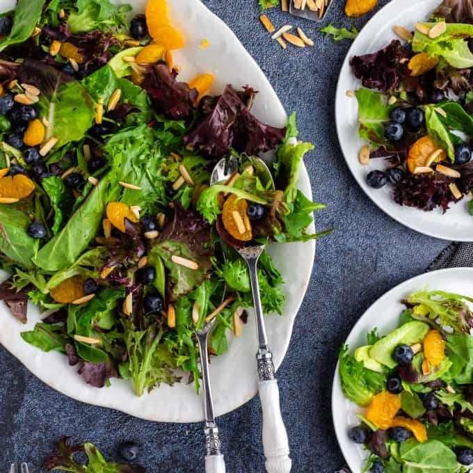 A colorful salad with oranges and blueberries