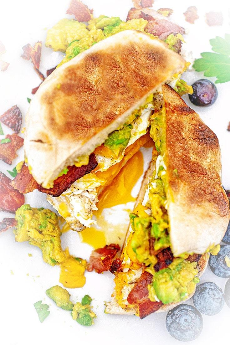Avocado breakfast sandwich, split in half.