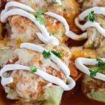 Keto Enchiladas with sour cream garnish