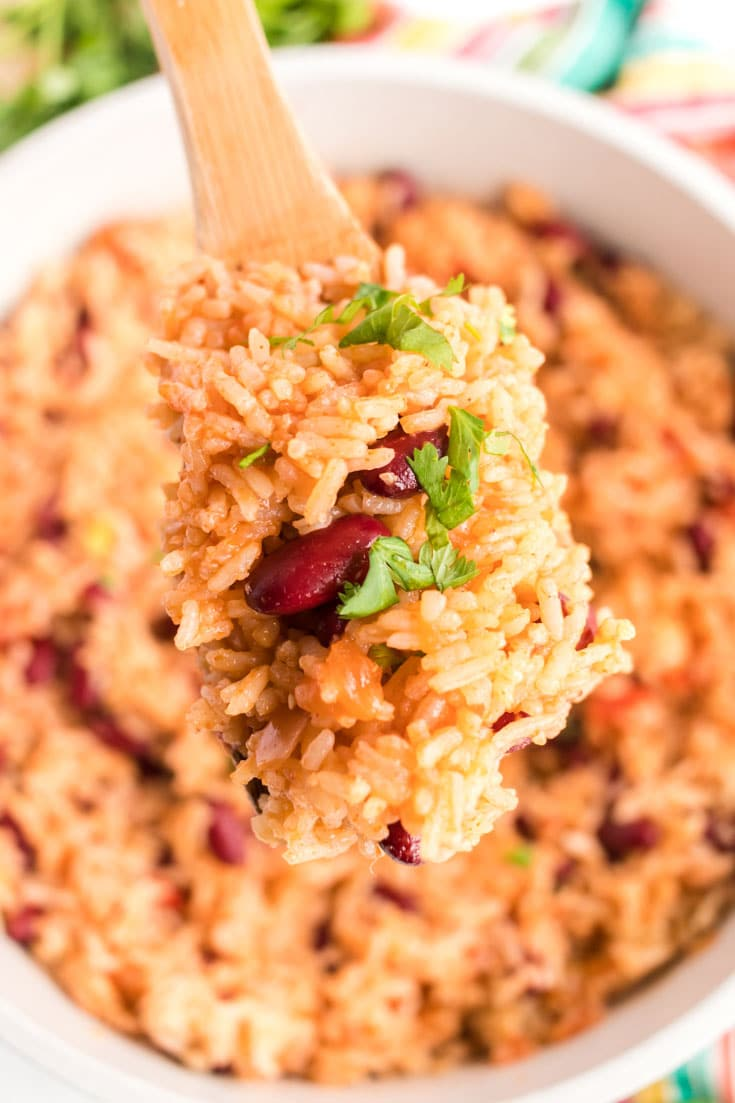 Wooden spoon of Mexican rice and beans.