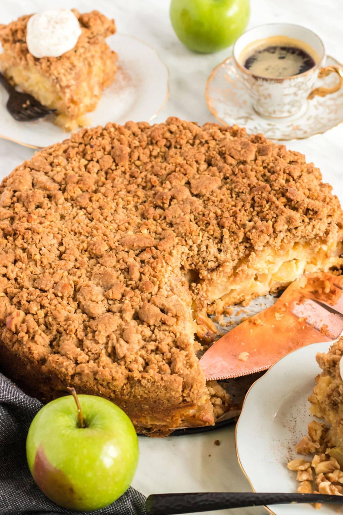 An apple buckle cake on a plate