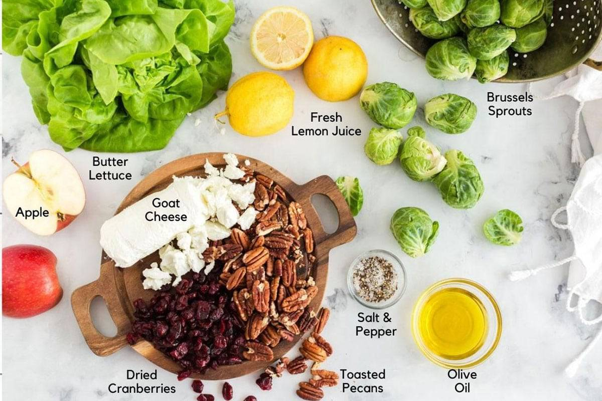 Lemons, Brussels sprouts, and other ingredients for a salad.