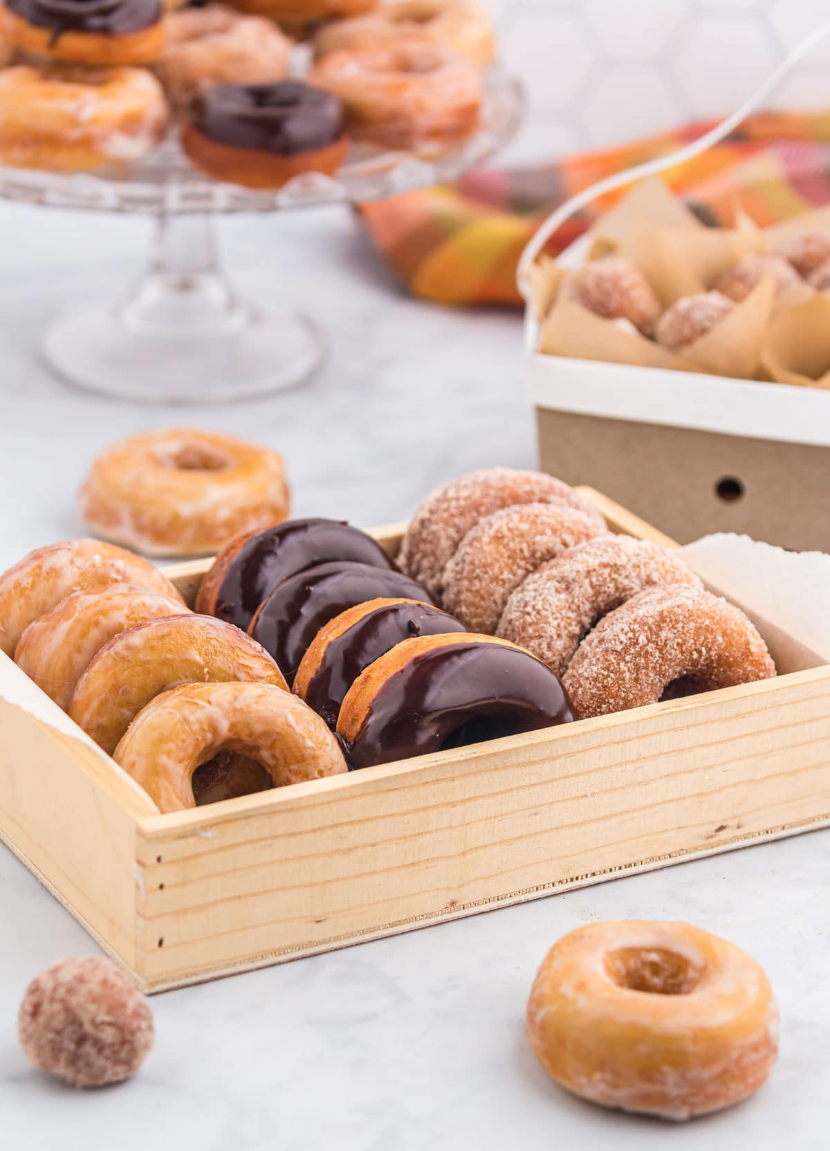 A variety of glazed donuts in a box