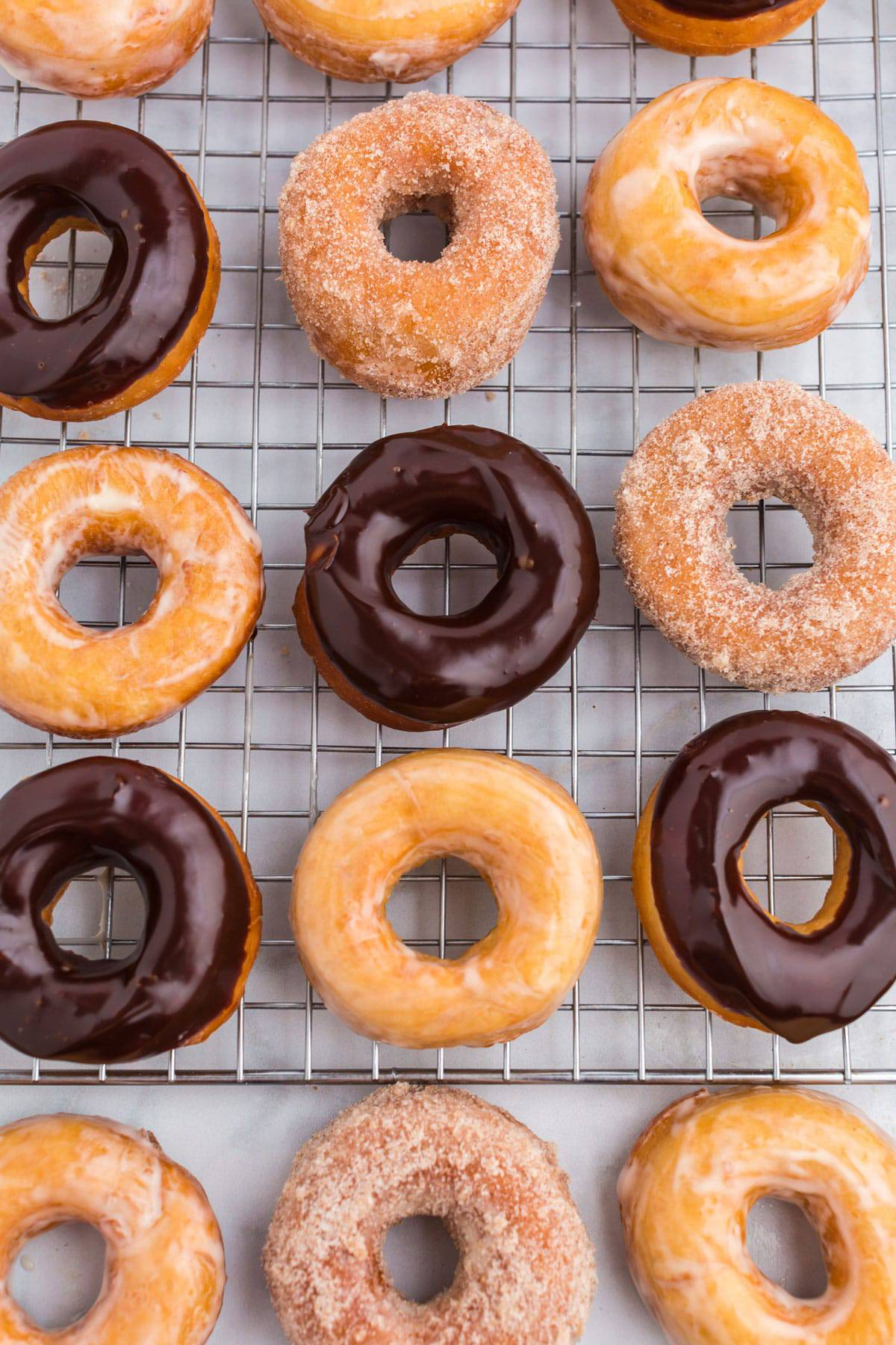 Raised donuts on a cooling rack