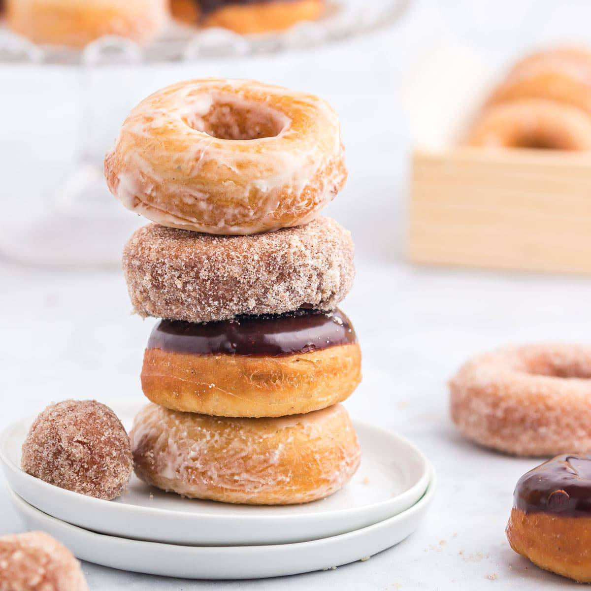 A stack of donuts on a plate