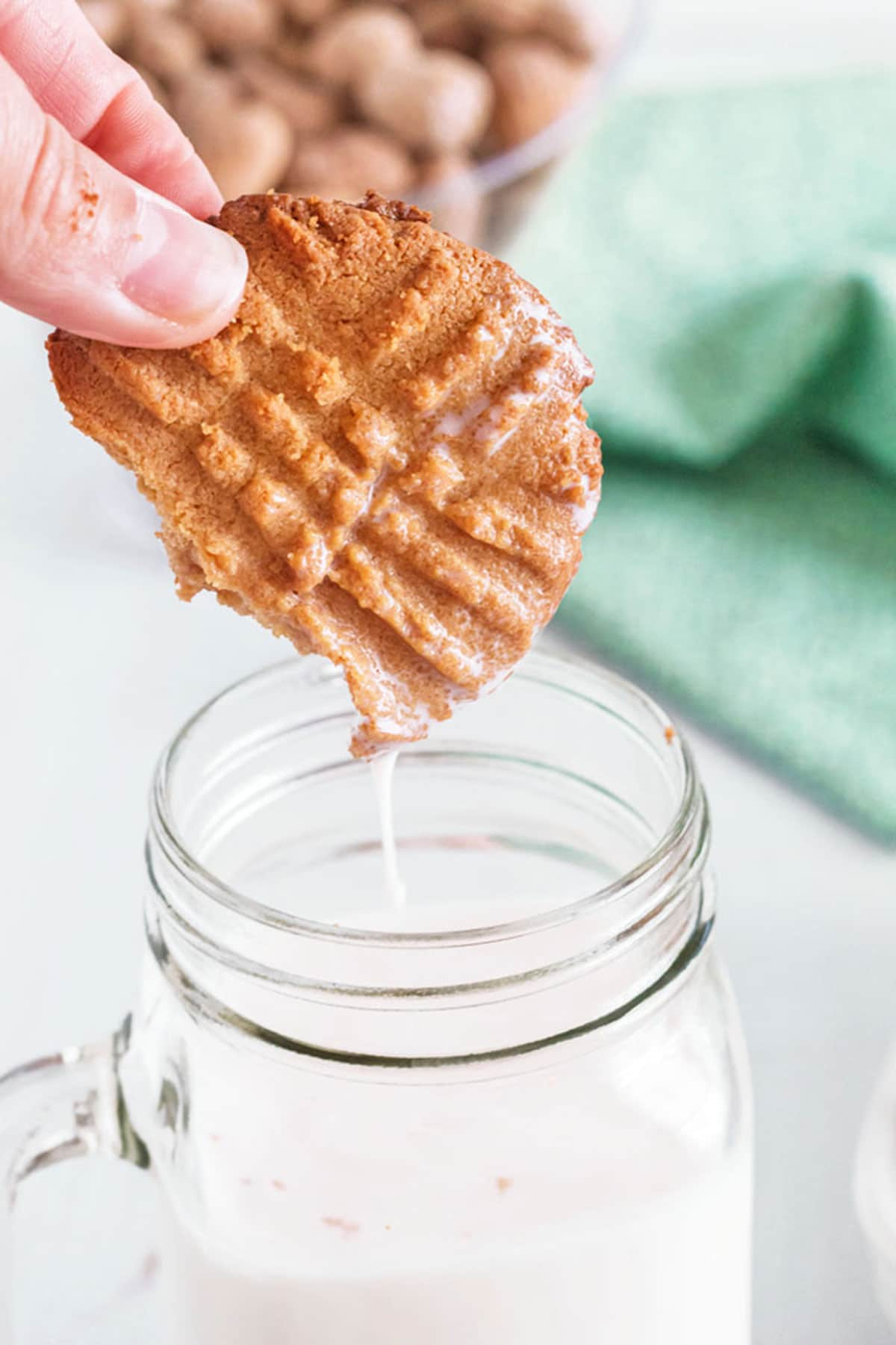 Dunking a cookie in a glass of milk