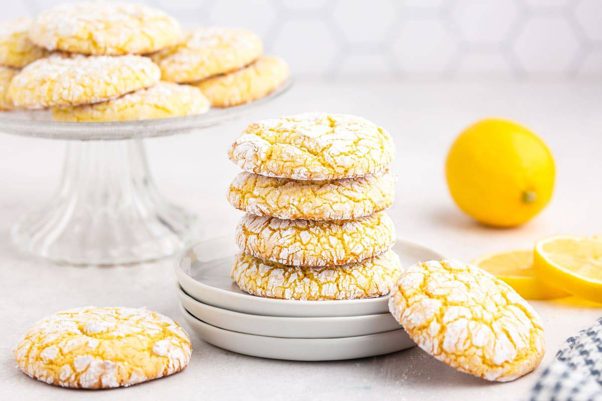 A batch cookies on a plate with a lemon.