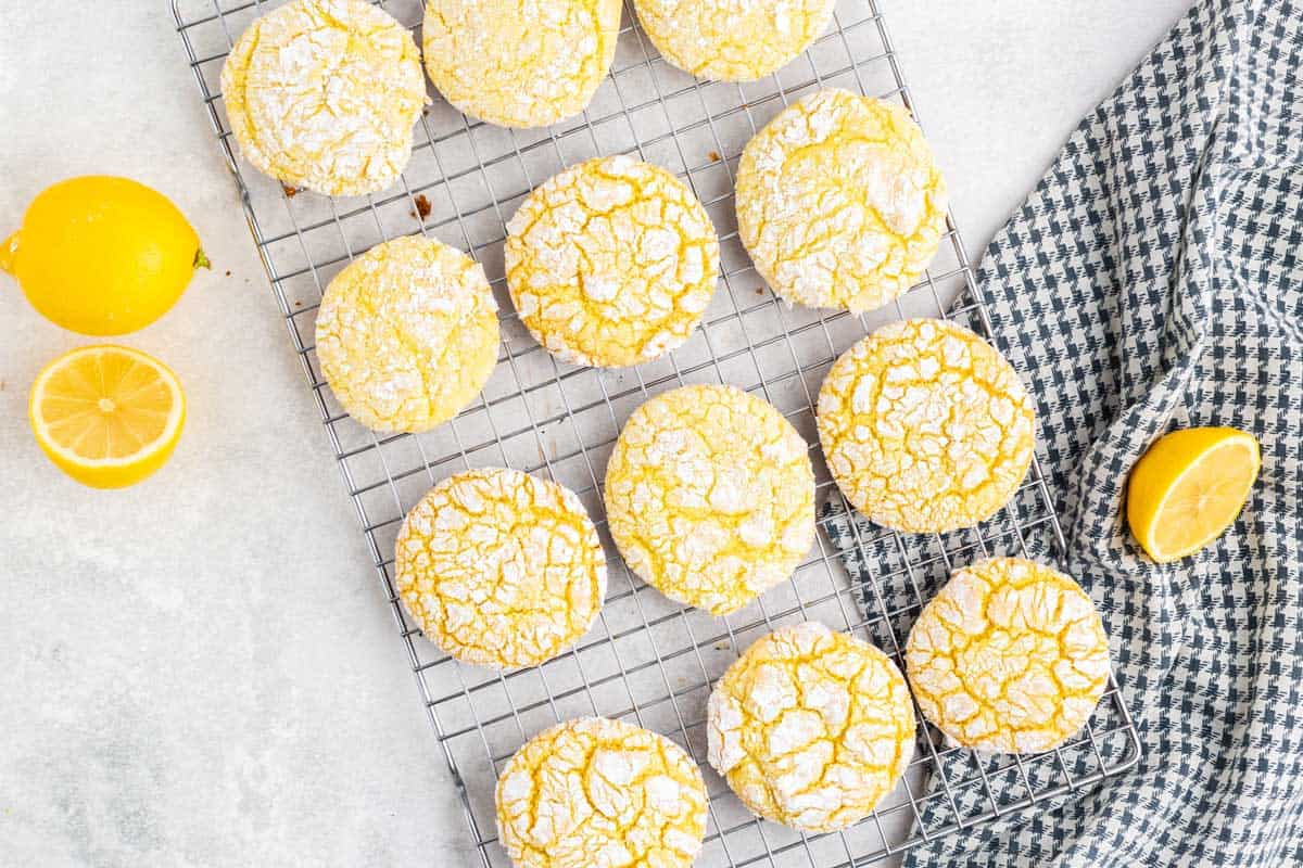 A bunch of lemon cookies in a cooling rack.