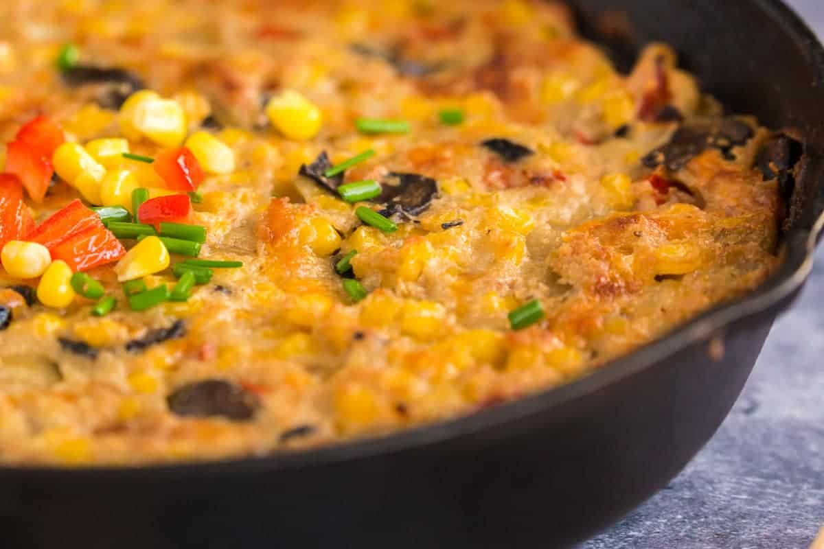 Close up of a baked corn casserole in a skillet
