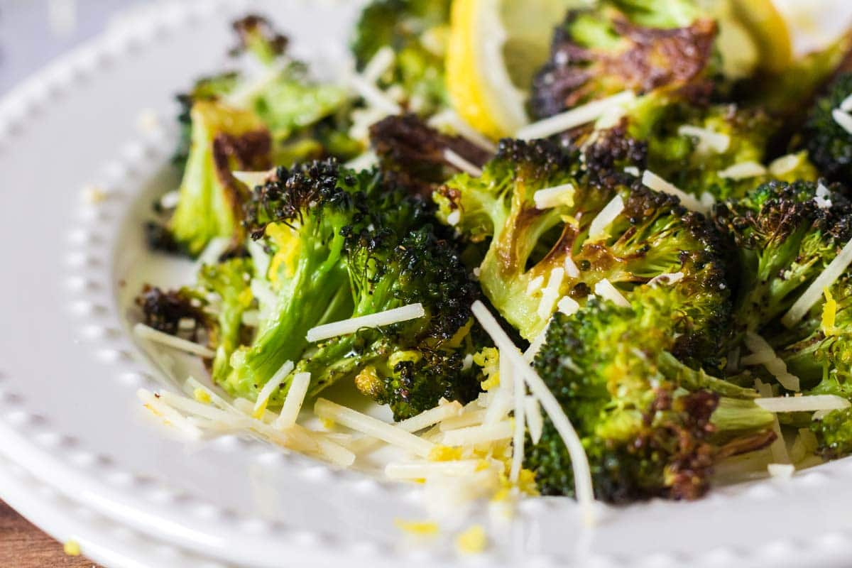 A plate or roasted broccoli and cheese