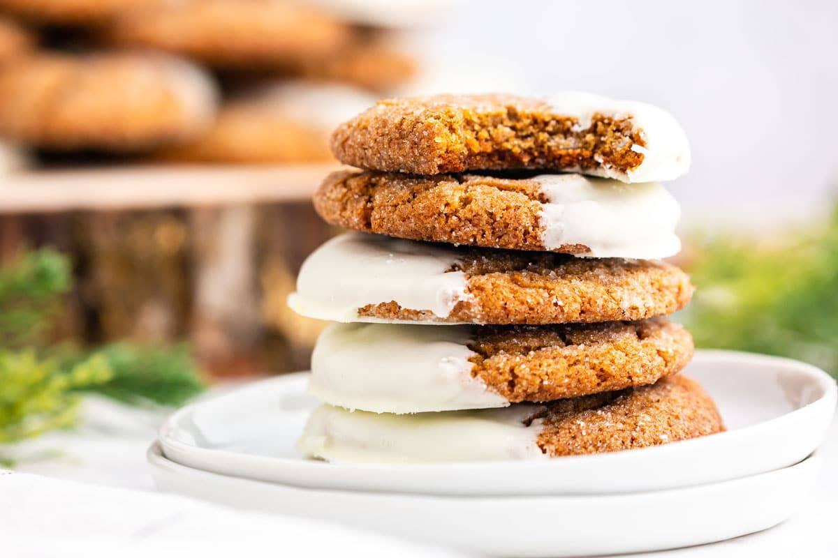 A stack of frosted ginger cookies