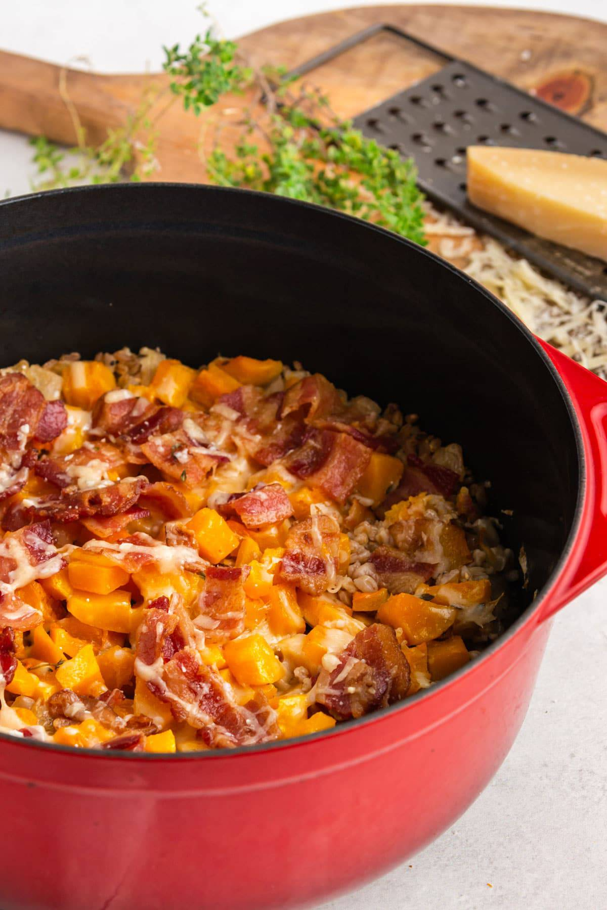 A casserole with bacon on top of it