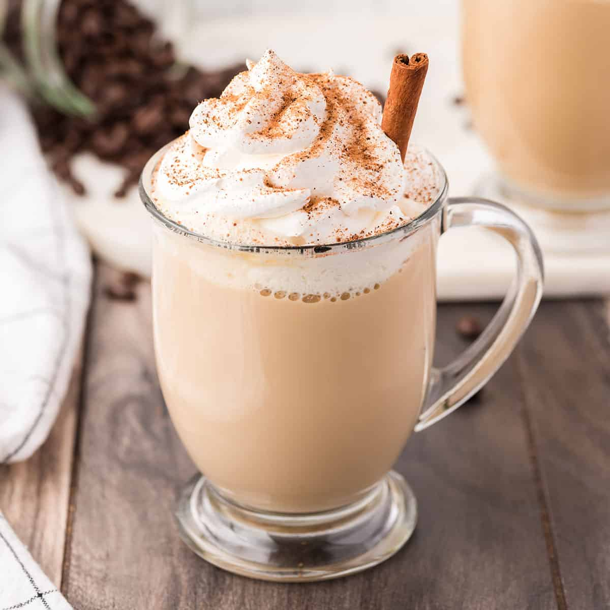 A glass of Eggnog Latte with cinnamon stick