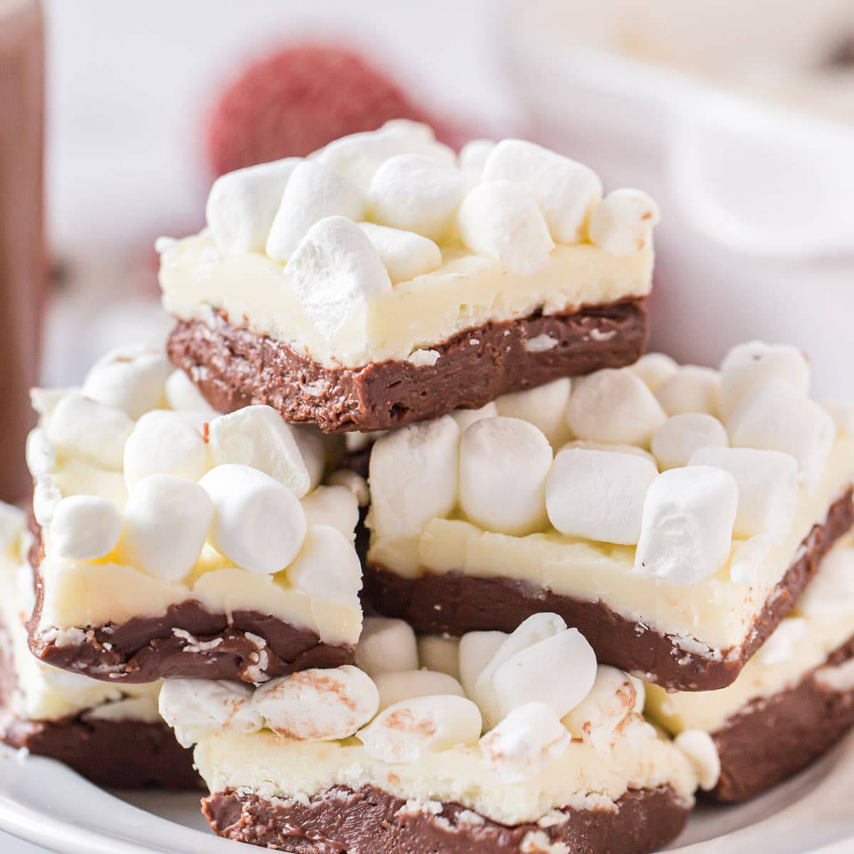 A pile of hot chocolate fudge topped with mini marshmallows.