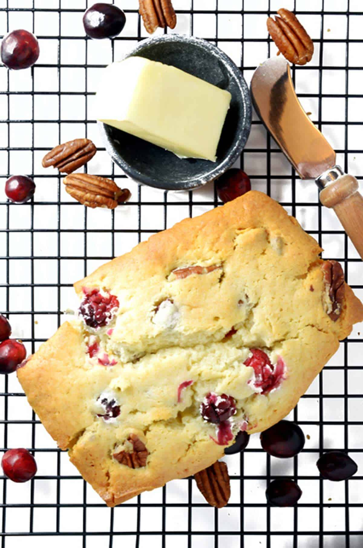 overhead view of cranberry nut bread on a cooling rack.