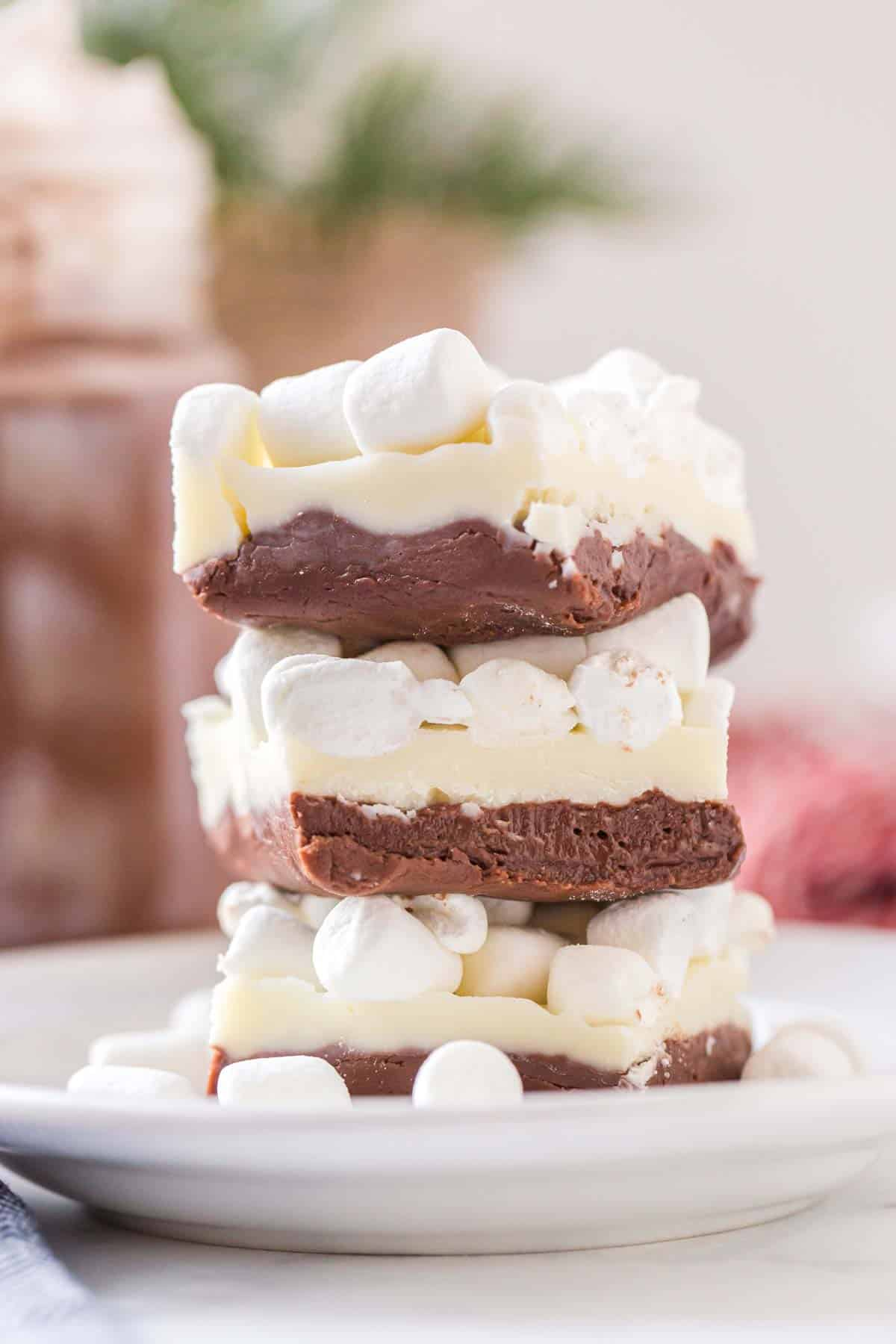 A stack of hot chocolate fudge, topped with mini marshmallows