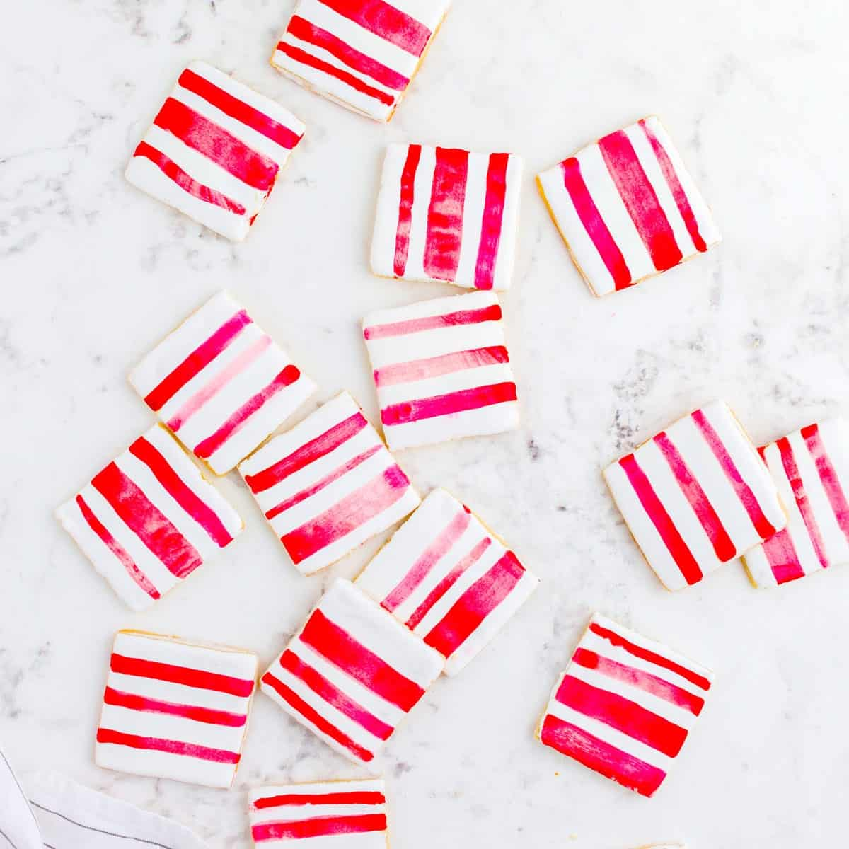 A bunch of red-striped peppermint sugar cookies