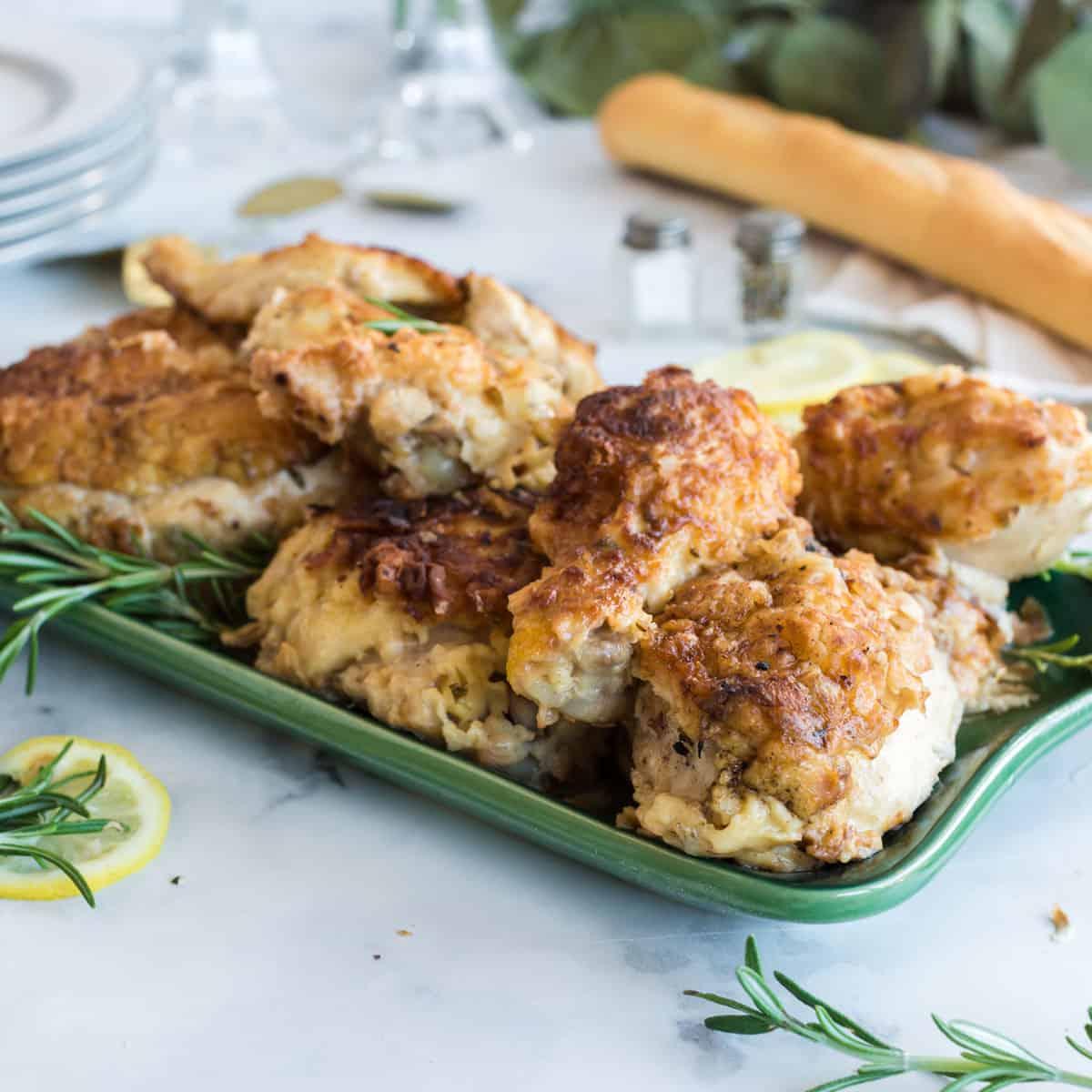 A serving platter of rosemary chicken.