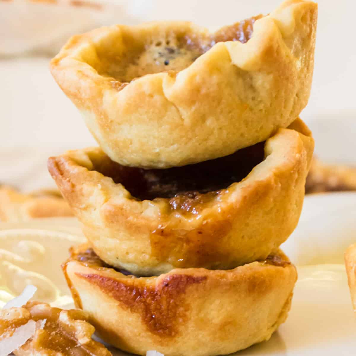 A stack of 3 butter tarts.