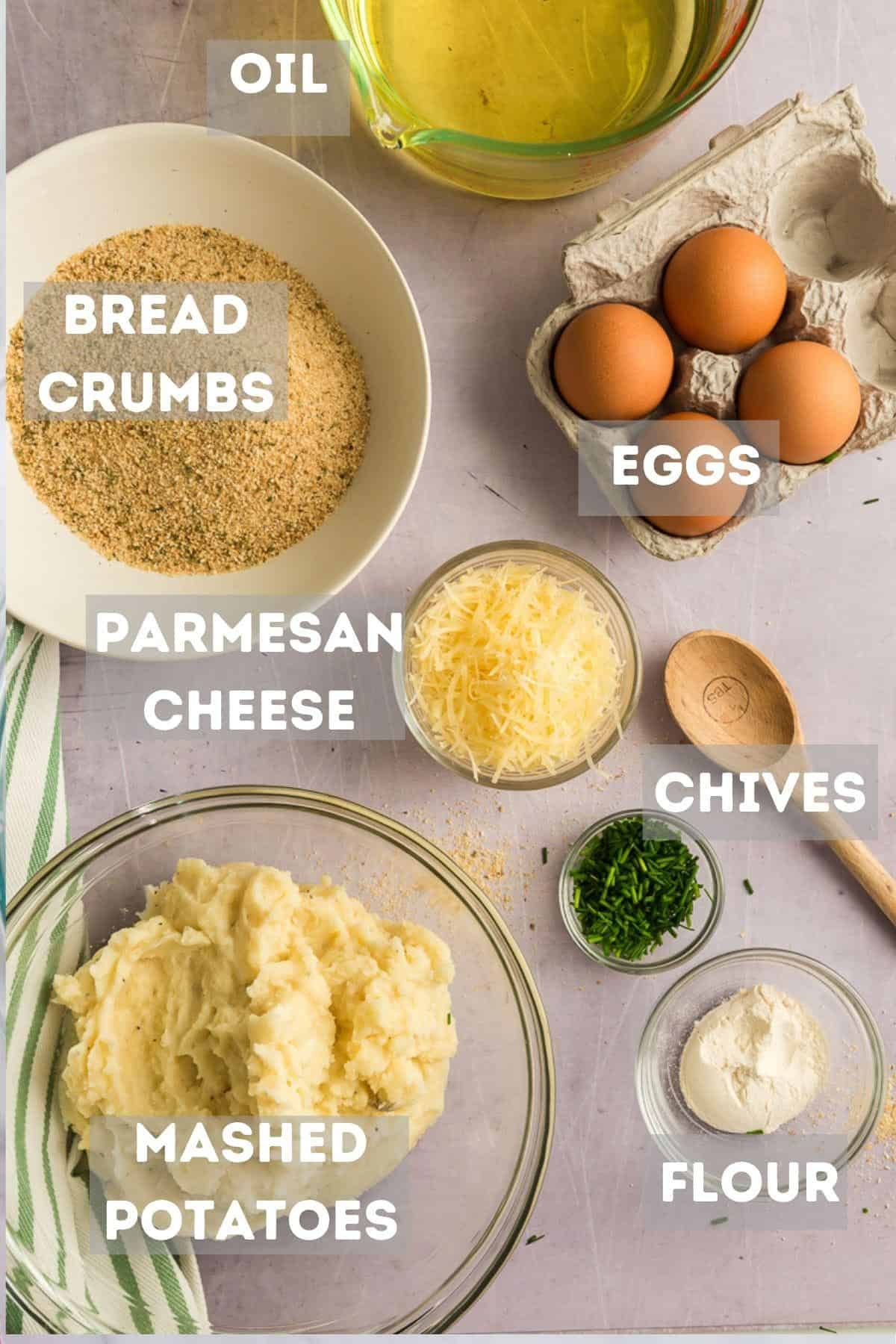 A bowl of mashed potatoes, cheese, and other ingredients for croquettes.