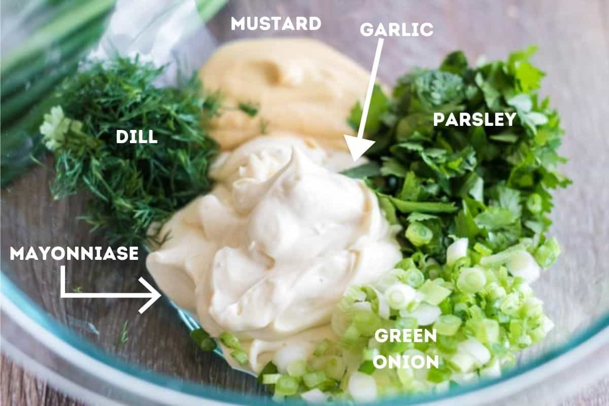 Ingredients for chicken salad in a mixing bowl.