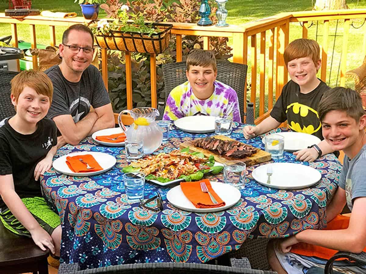 A family eating outside.