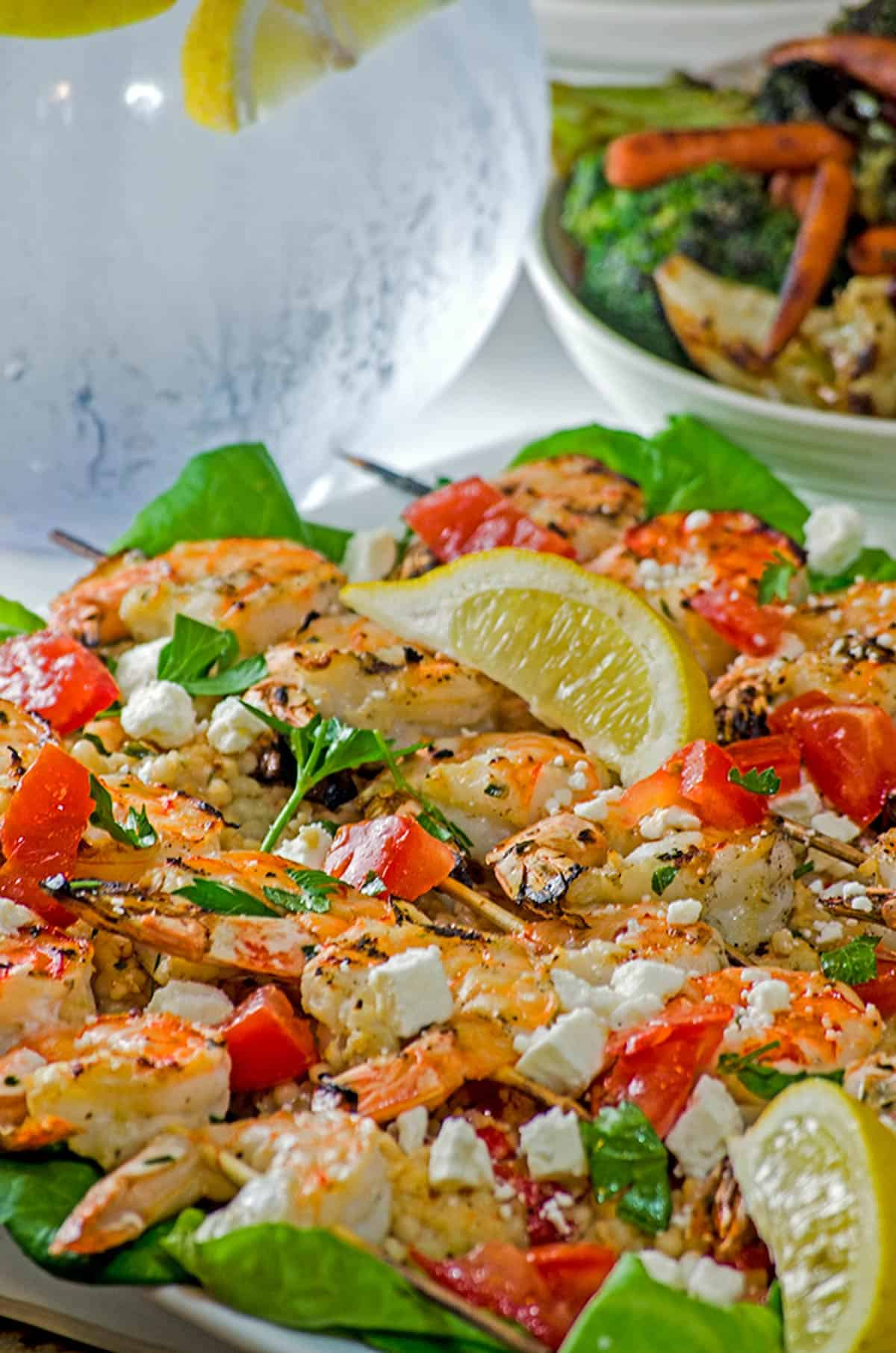 A plate of shrimp with feta cheese.