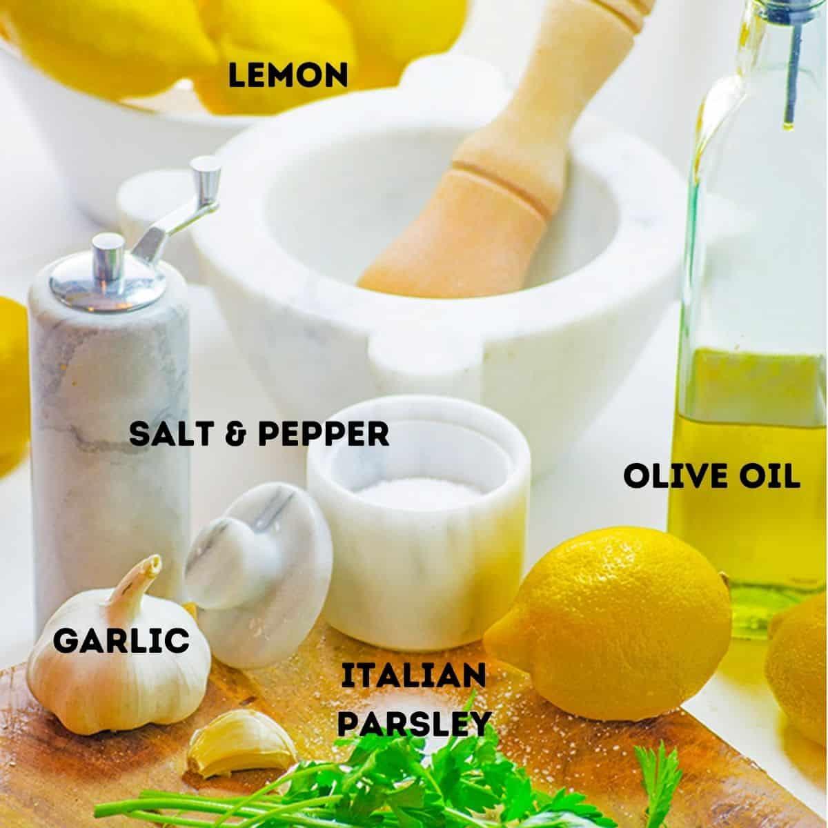 Lemon, olive oil, garlic, and other ingredients to marinate shrimp.